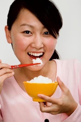 Young Lady Eating with Chopsticks